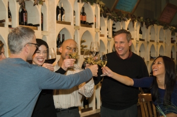 WineStyles customers toasting in WineStyles store.