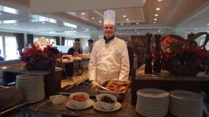 Chef Stefan Serving Lamb Shank Normandie